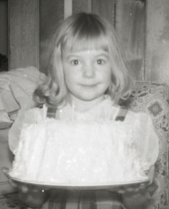 Mom always made fancy birthday cakes.  This is me with my angel food cake.  It's almost as big as I am!